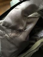 Damaged strap before